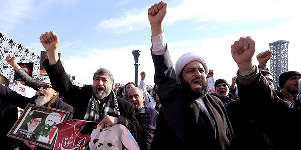 Angry Iranian protesters at Imam Husain Square in Tehran chant slogans during a demonstration against the execution of Shiite cleric Sheikh Nimr al-Nimr in Saudi Arabia. (Photo: AP)