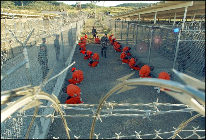 Guantanamo_captives_wait_during_processing_on_January_11th,_2002 (1)